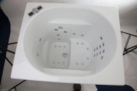 Oronsay japanese style bath with slender whirlpool jets